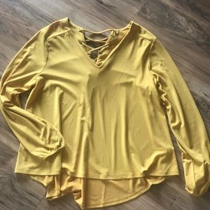 Ladies' blouse size L. Mustard yellow with detail.